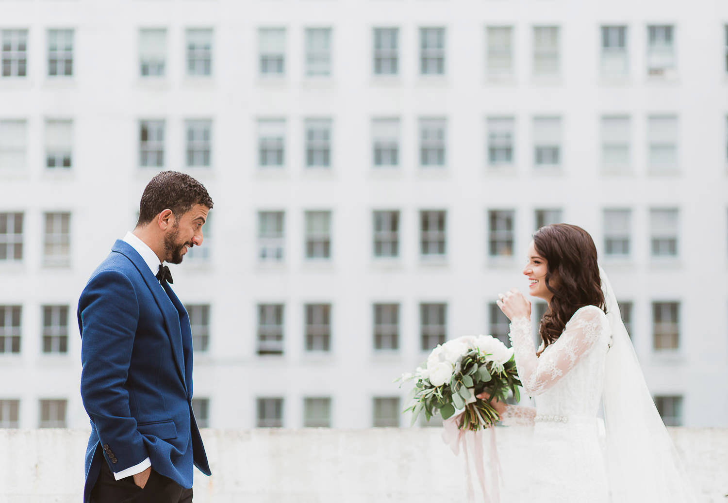 A beautiful skyline first look with a gorgeous and stylish couple