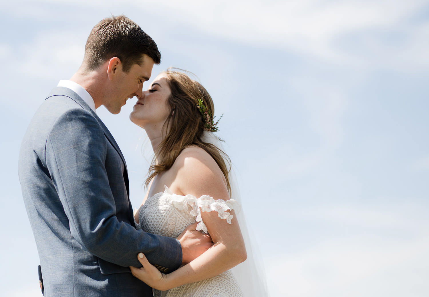 Seaside first look with gorgeous Rue De Seine bride