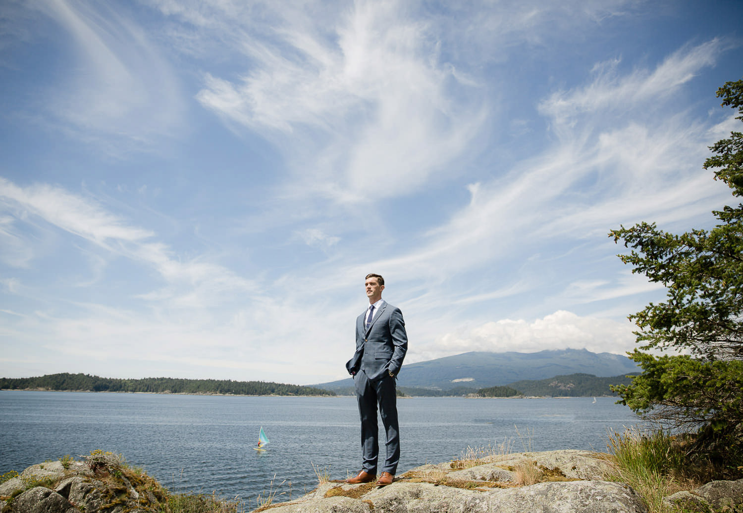 Intimate seaside bohemian wedding - The groom is waiting his beautiful bride | Photo: Camilla Anchisi