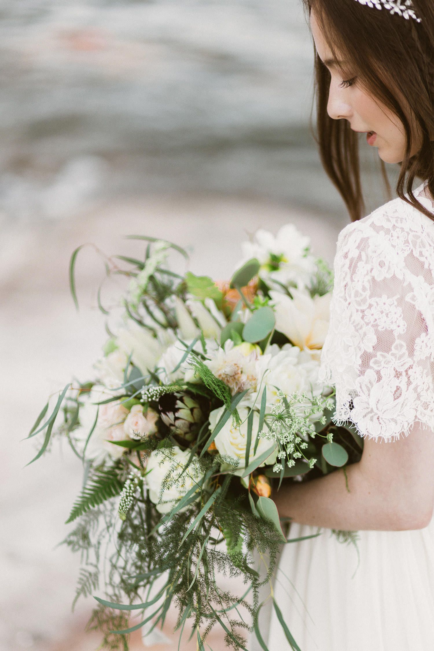 Ethereal and elegant bride with a lush, flowing and botanical inspired bouquet. Photo: Camilla Anchisi