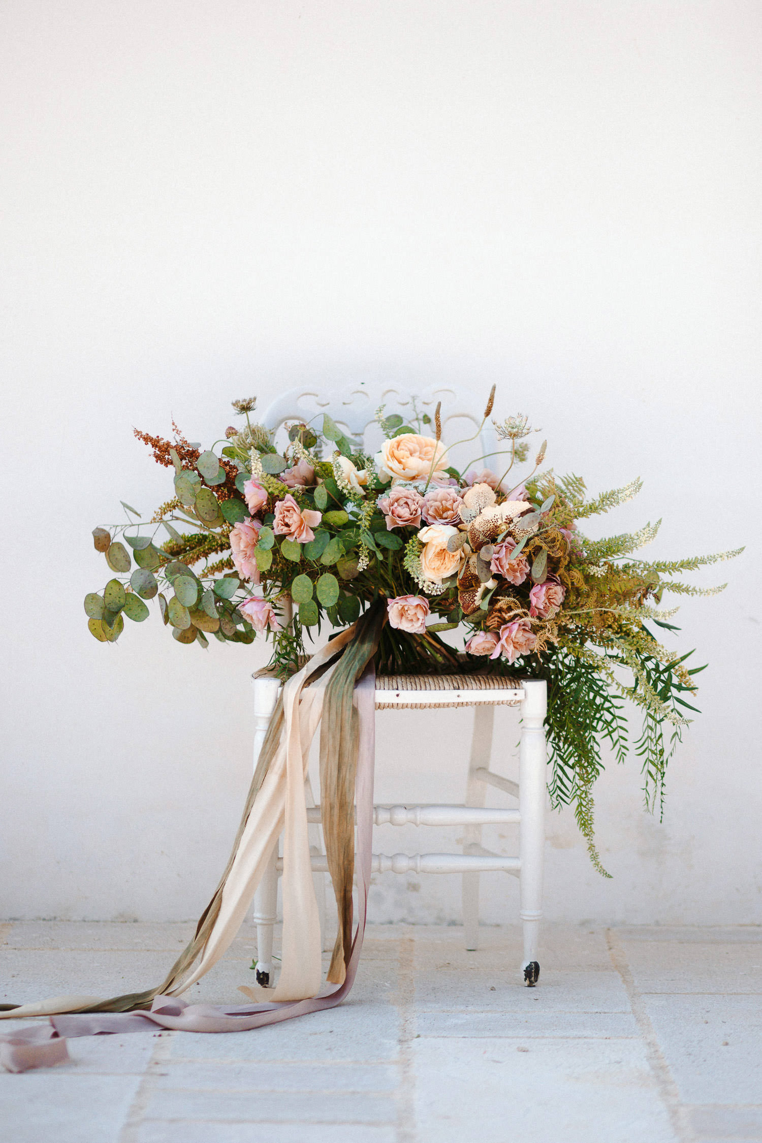 Gorgeous wedding bouquet with lush greenery made by Chiara Sperti floral events - Photo: Camilla Anchisi