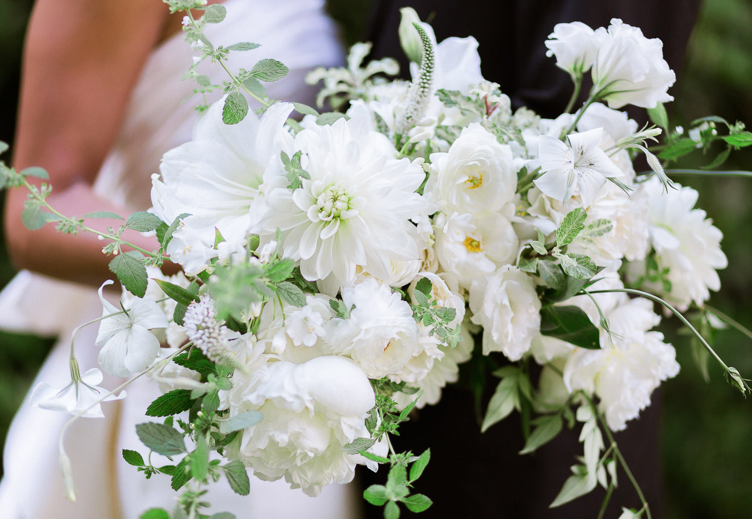 Gorgeous organic bouquet with white blooms by Celsia Florist