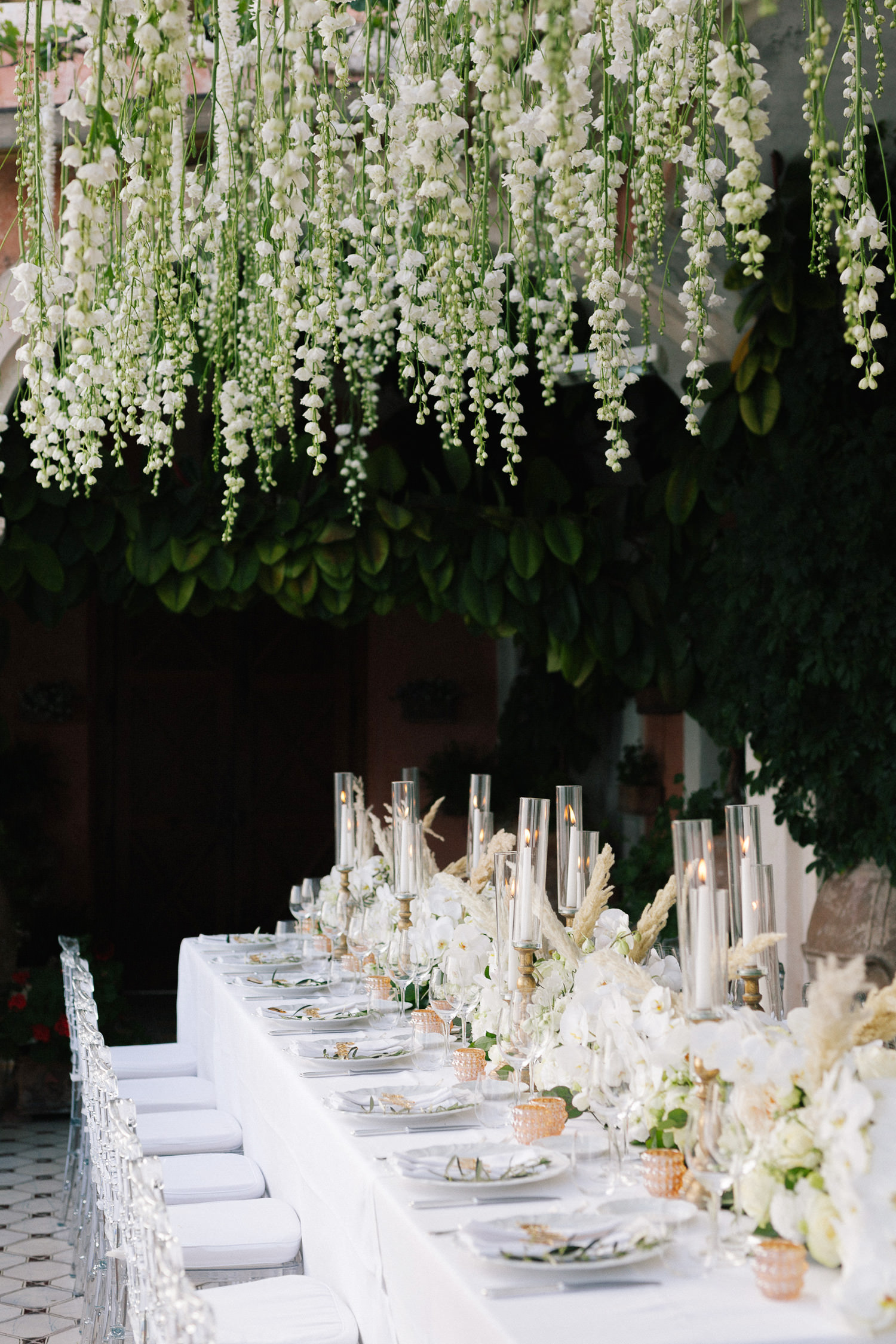 Positano Villa San Giacomo luxury wedding, stunning setting with hanging blooms | Photo: Camilla Anchisi Photography | Planning: Weddings Italy | Florals: FloraGardenaldo